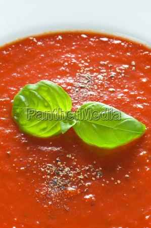 basil garnish on tomato sauce