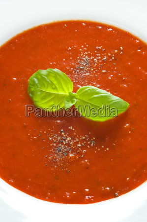 basil herb garnish on tomato sauce