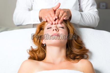 wellness woman receiving head massage