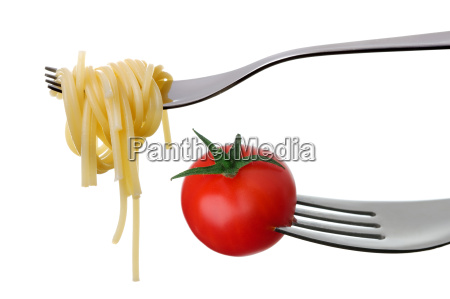 spaghetti and tomato on forks isolated