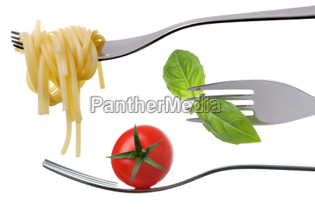 spaghetti basil and tomato on forks