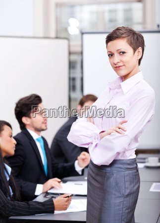 young successful businesswoman laughing with conference