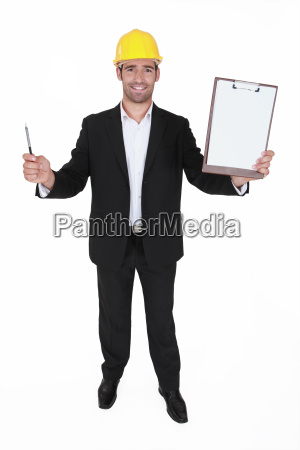 happy man holding clip board and