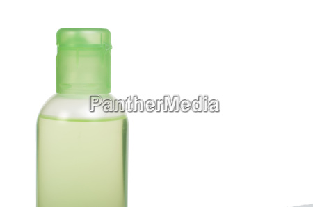 green transparent cosmetic bottle