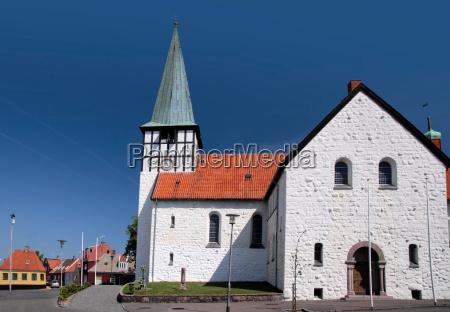 white st nicholas church in roenne