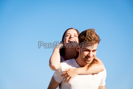 young couple in love laughing carefree