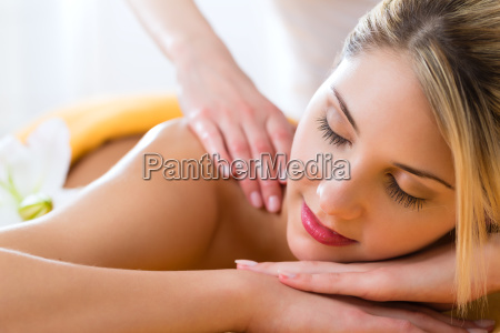 wellness woman gets back massage