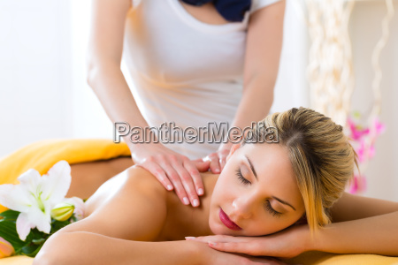 wellness woman receiving back massage in