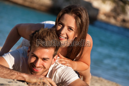 young couple in love laughing at