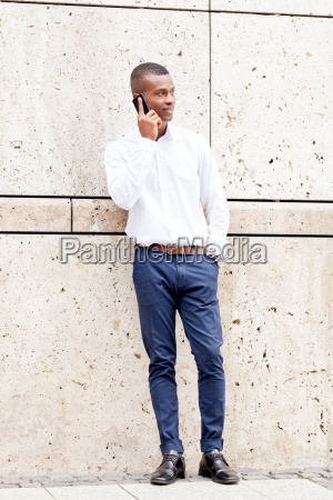 young successful man with mobile phone