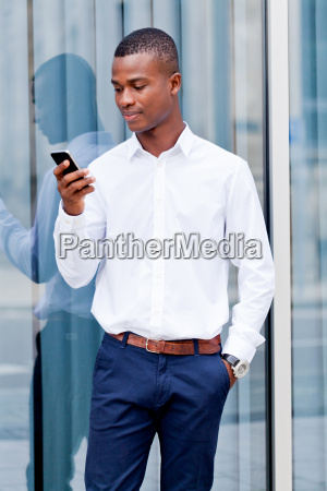young successful man with cellphone in