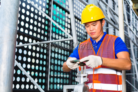 house technician or industrial worker works