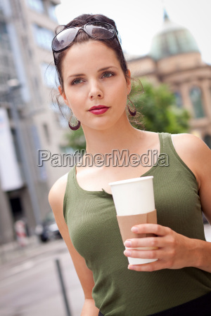 young attractive woman with coffee to