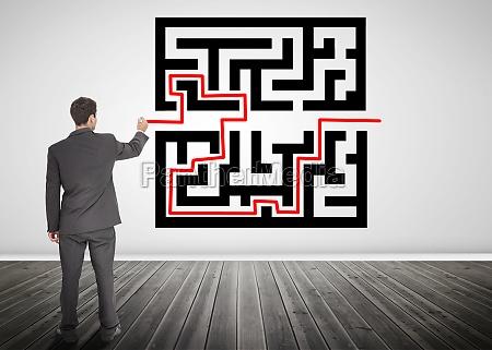 imprenditore disegnando una linea rossa attraverso