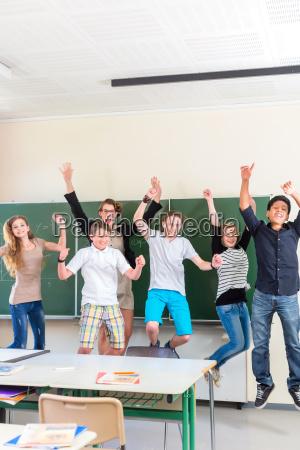 teacher motivates students of a class