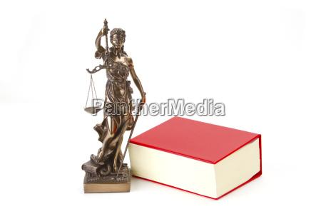 justizia con un libro di statuto