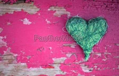 green heart on pink
