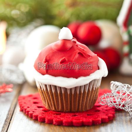 piccolo cupcake con cappuccio di babbo