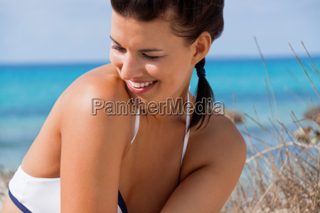 laughing happy young woman in summer