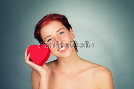 young happy woman with red heart