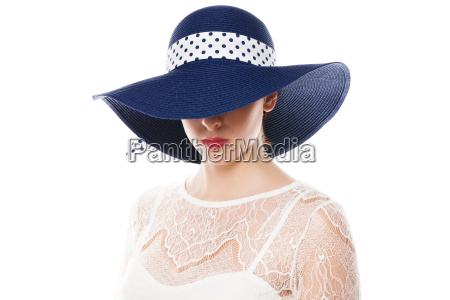 sun hat covering the eyes of
