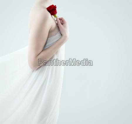 woman holding red rose on her