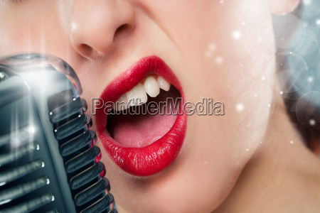 mouth of a woman while singing