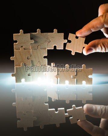 wooden puzzle and backlight background close
