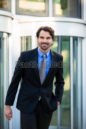 young trendy businessman in front of
