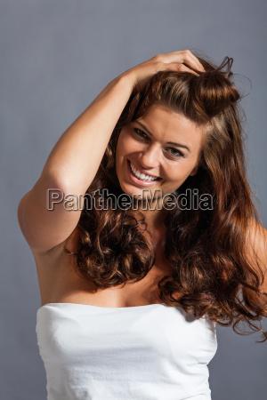 young attractive brunette woman with curly