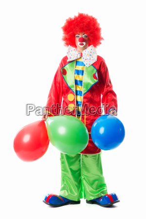 sad clown with balloons