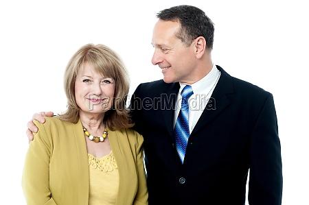 senior couple posing together
