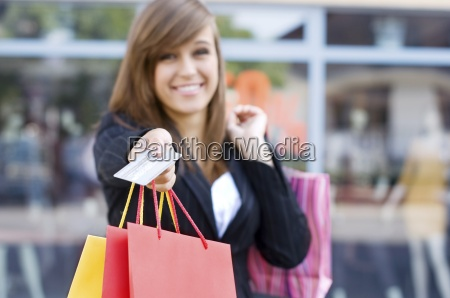 young woman with shopping bags and