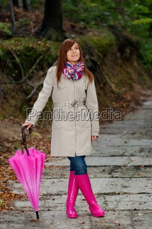 cute, young, woman, with, umbrella, wearing - 12108796