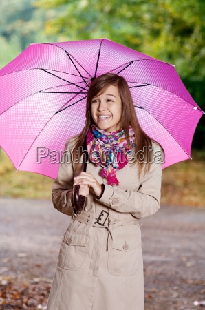 cute young woman with umbrella