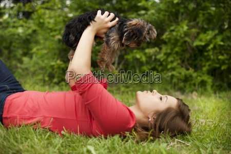 young woman holding cute puppy