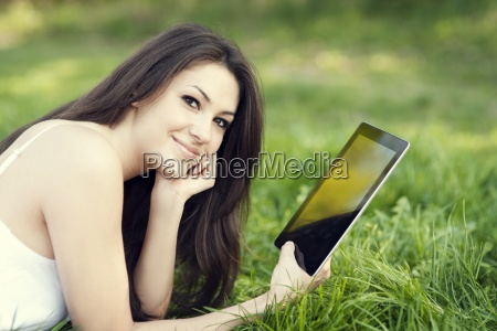 young woman using digital tablet on