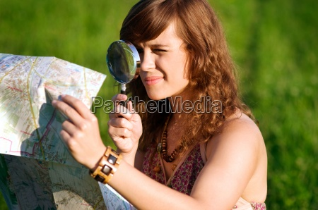 beauty woman looking through magnifying glass