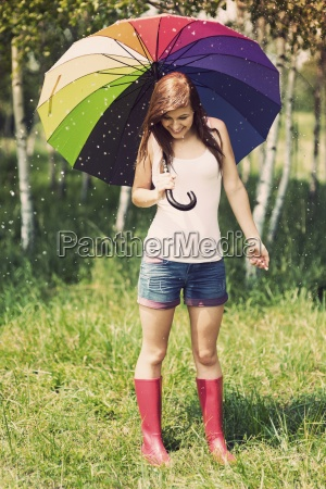 smiling woman in rainy summer day