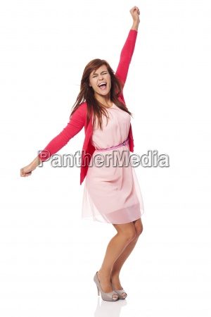 young beautiful woman screaming of joy