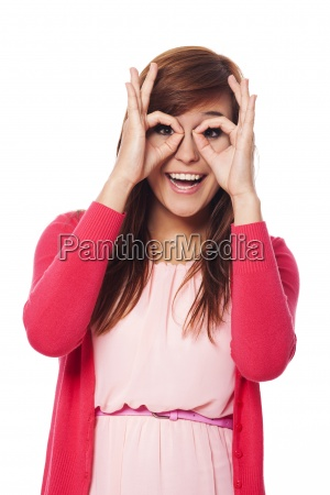 happy young woman making hand gesture