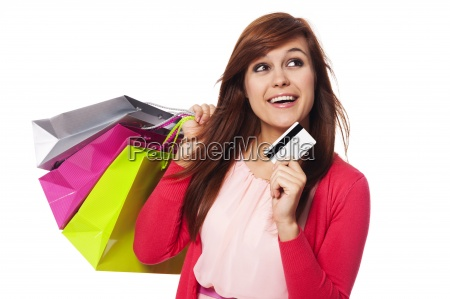 dreaming woman with shopping bags and