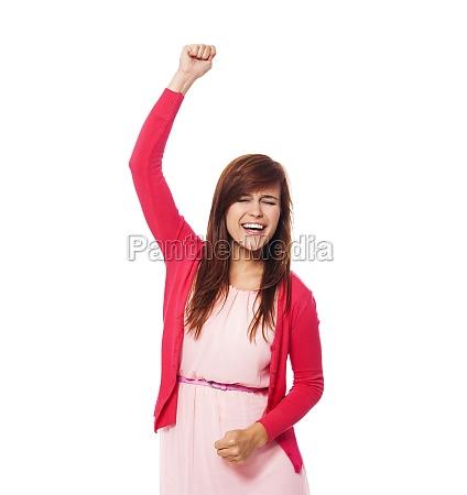 cheering beautiful young woman