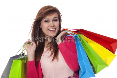 young woman holding shopping bags and