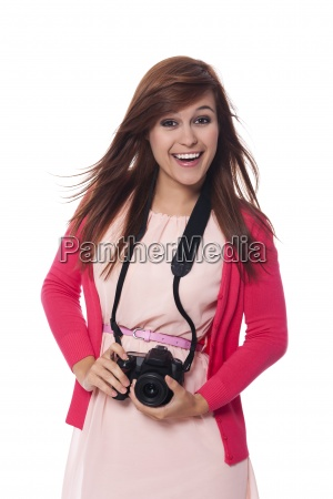 attractive young woman holding digital camera