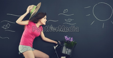 woman with hat during cycling