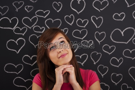 woman looking up lovingly with hearts