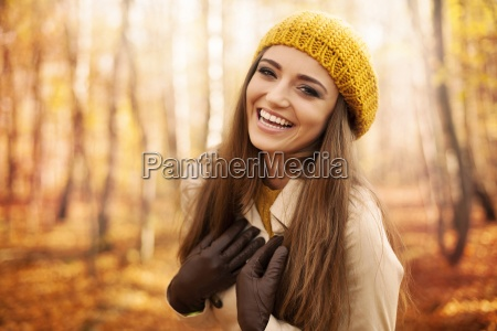 young woman wearing autumn clothes laughing