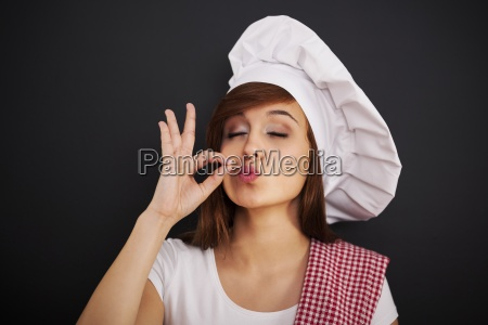 beautiful, young, female, chef, with, hand - 12109852