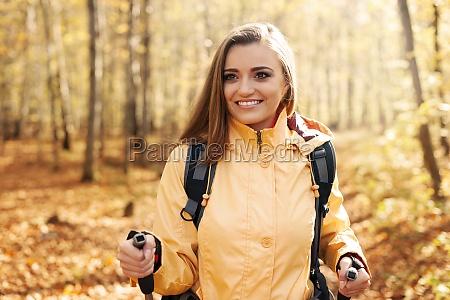 active beautiful woman hiking in autumn